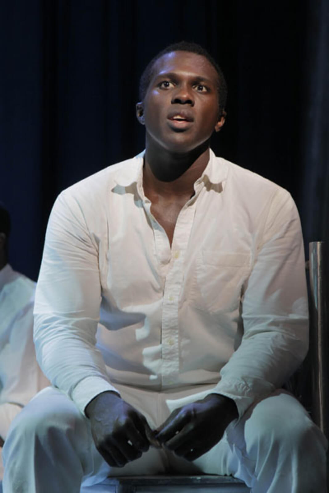 """Haywood Patterson (Joshua Henry) singing """"Go Back Home"""". He is singing from his jail cell dressed in white."""