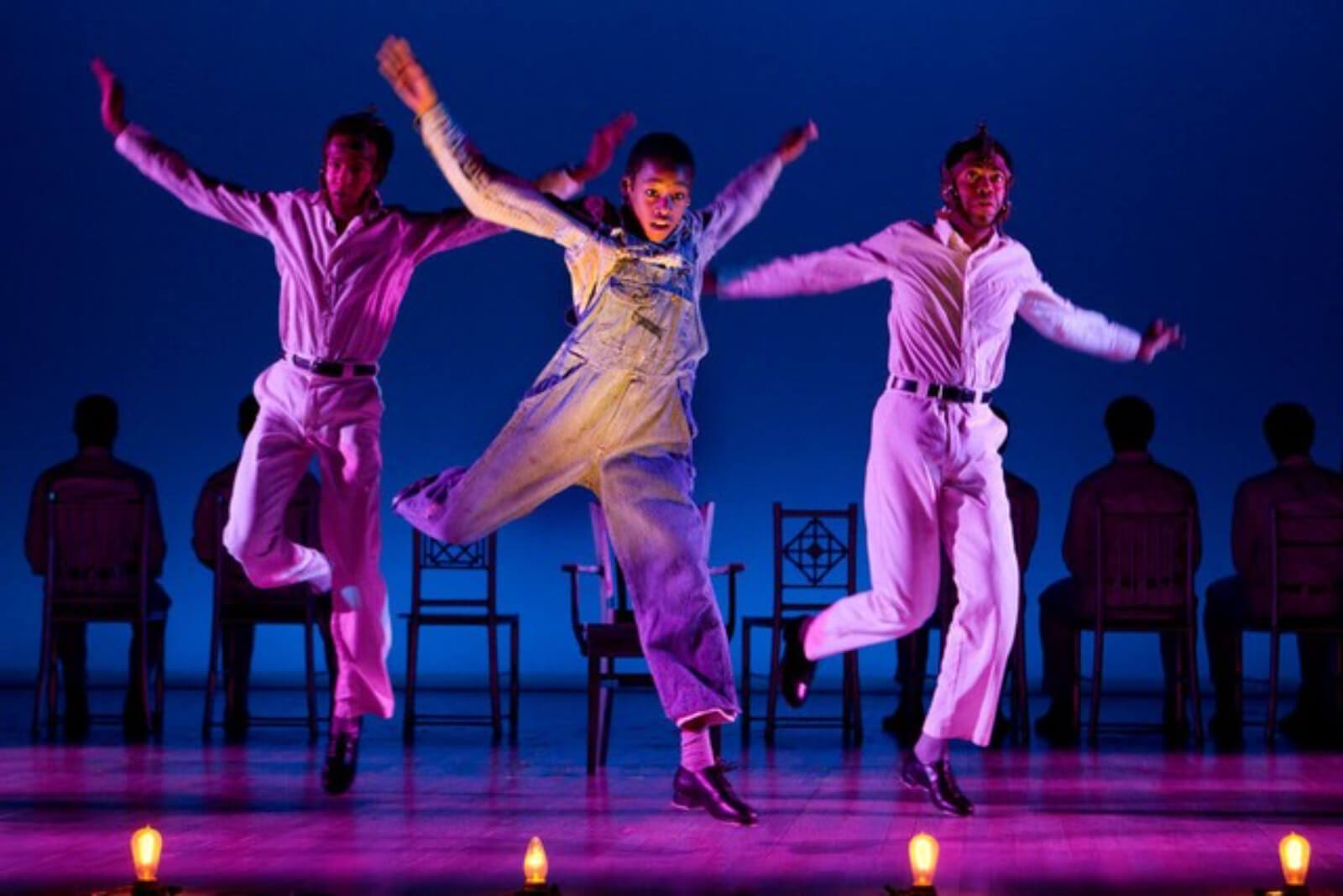 """Willie Roberson (Kendrick Jones), Eugene Willams (Jeremy Gumbs), and Roy Wright (Julias Thomas III) tap dance to """"The Electric Chair"""". They are bathed in purple light doing fancy tap steps."""