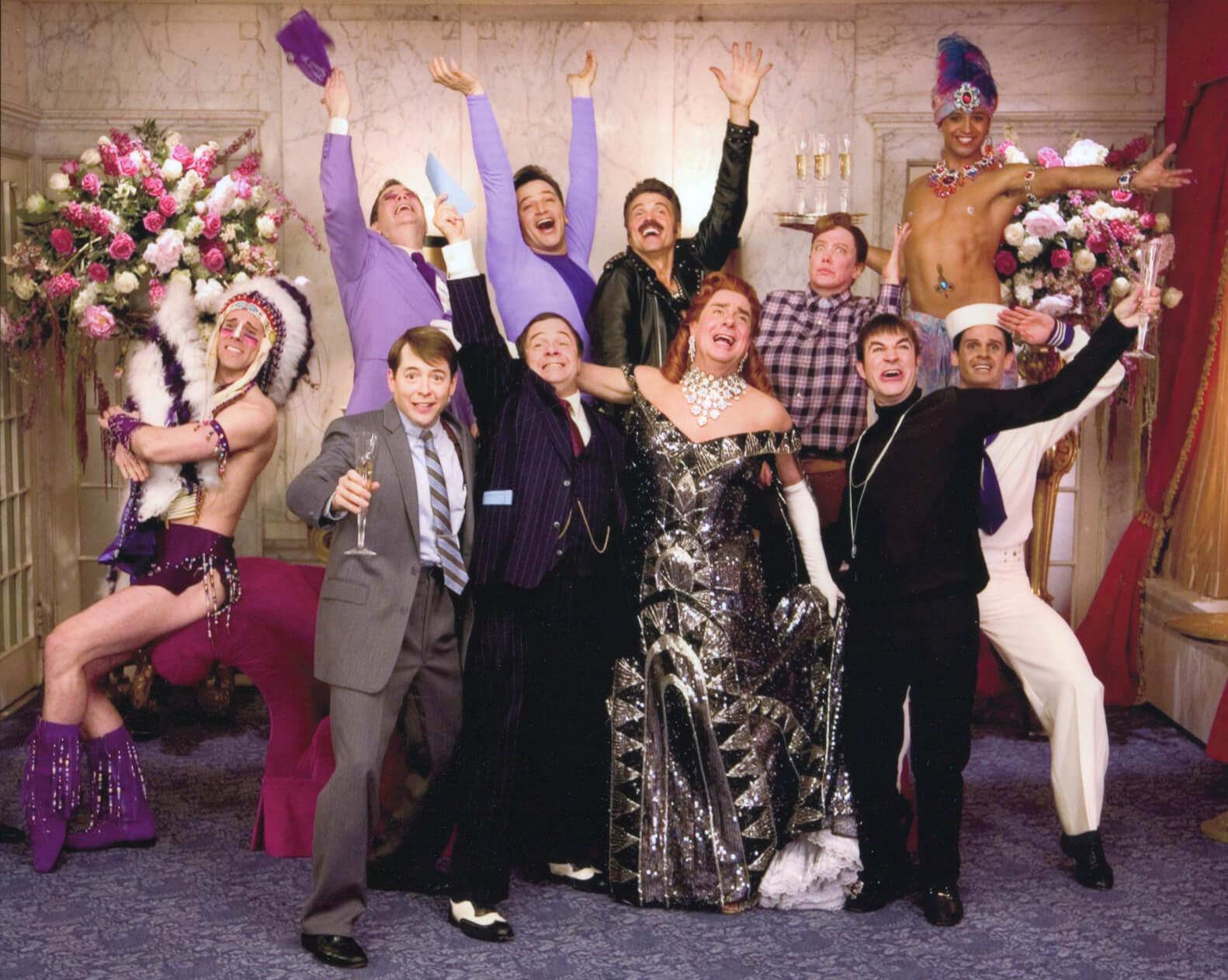 "Leo Bloom (Matthew Broderick), Nathan Lane (Max Bialystock), Roger Debris (Gary Beach) and Carmen Ghia (Roger Bart) celebrating with friends singing ""Keep it Gay""."
