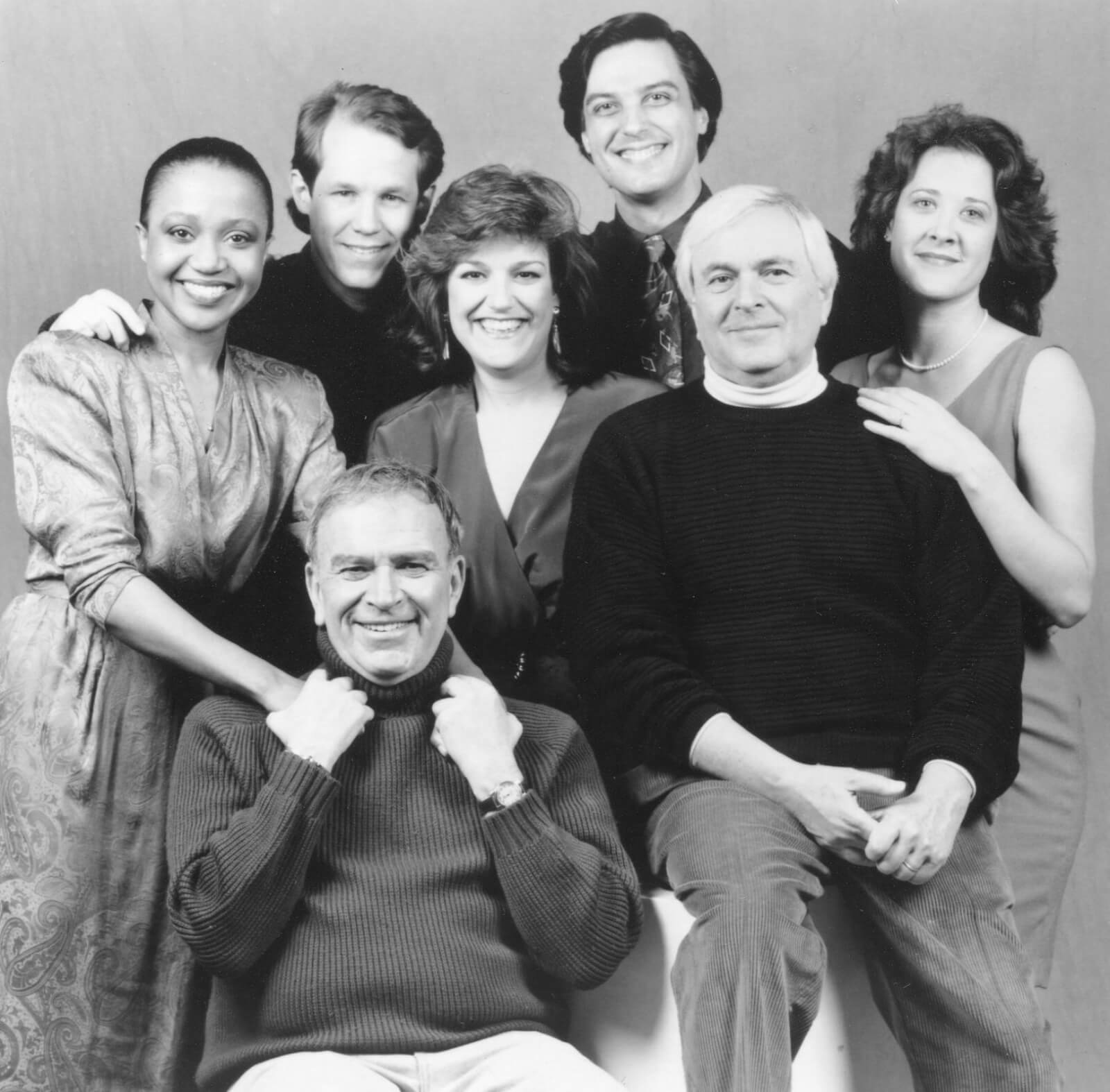 Black and white portrait of the cast and creatives of And The World Goes Round