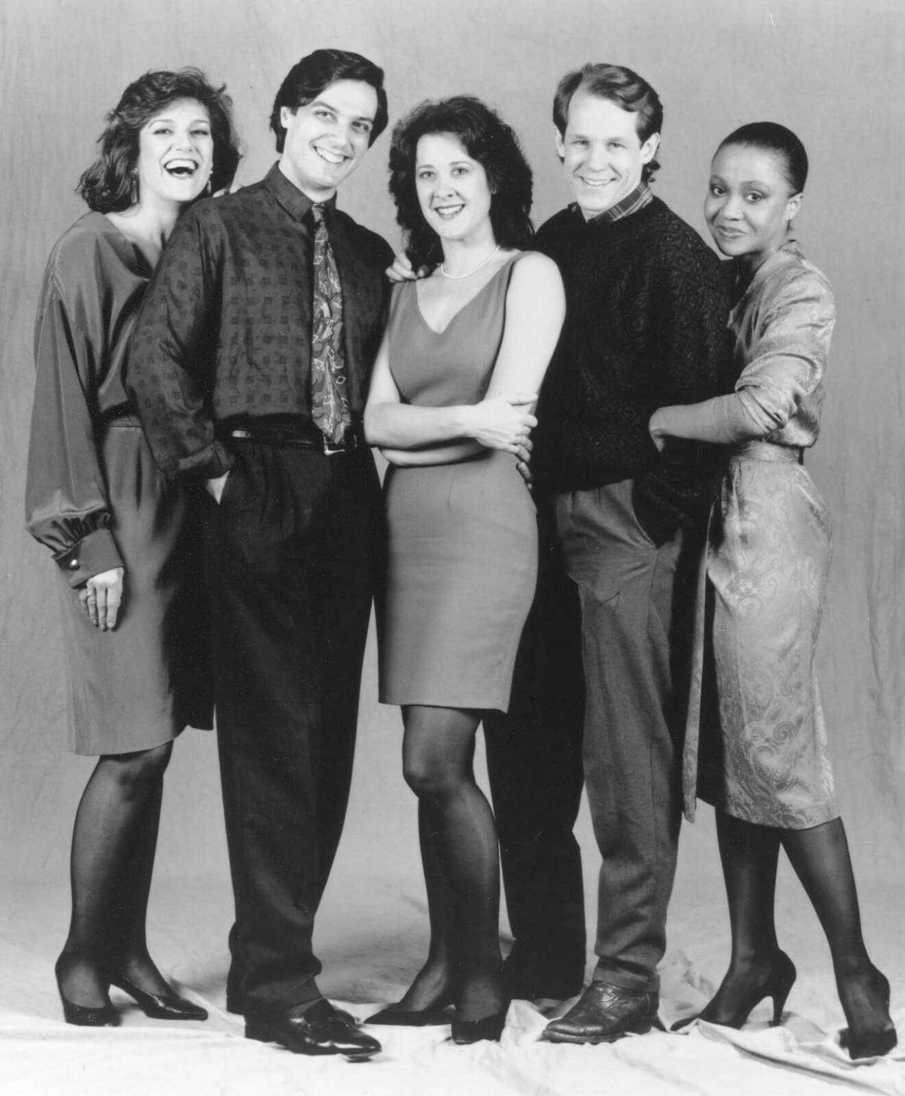 A black and white press photo of the full cast