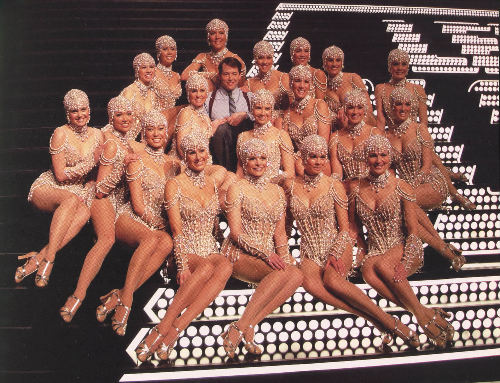 Leo Bloom (Matthew Broderick) and The Pearl Girls. Matthew is surrounded by beautiful woman dressed in pearl costumes.
