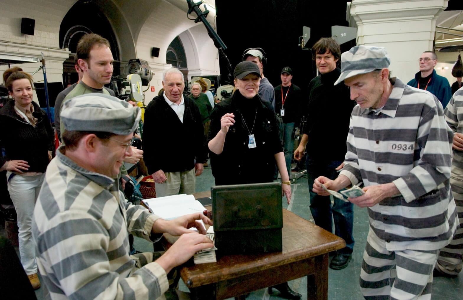 "AD Sam Hoffman, Mel Brooks, Susan Stroman, sound mixer Todd Maitland watch Matthew Broderick convince jailbird to invest in ""Prisoners of Love""."