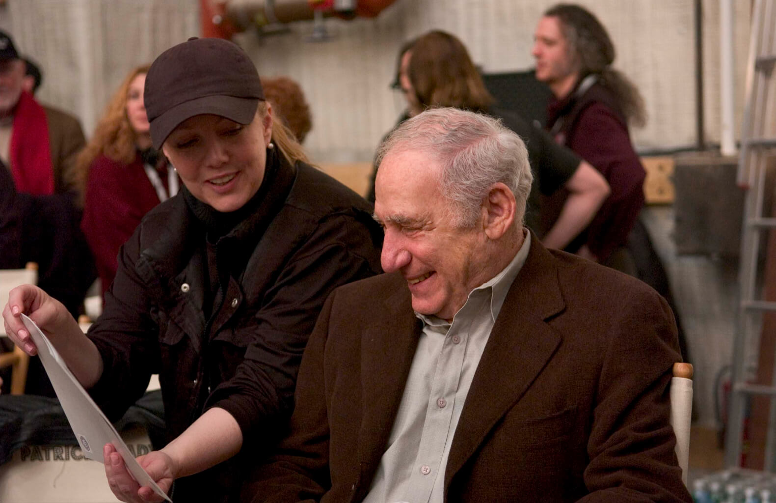 Susan Stroman and Mel Brooks during rehearsal. Stro is showing Mel some photos.