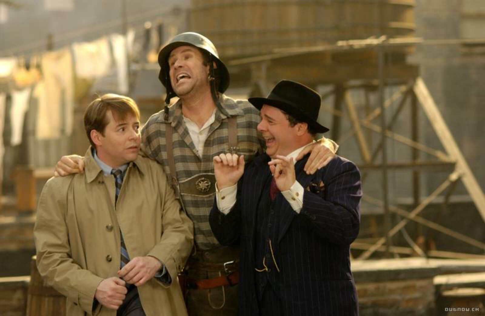 """Leo Bloom (Matthew Broderick), Franz Liebkind (Will Ferrell) and Max Bialystock (Nathan Lane) doing """"Der Guten Tag Hop-Clop"""". They are standing on a roof top. They are swaying together."""