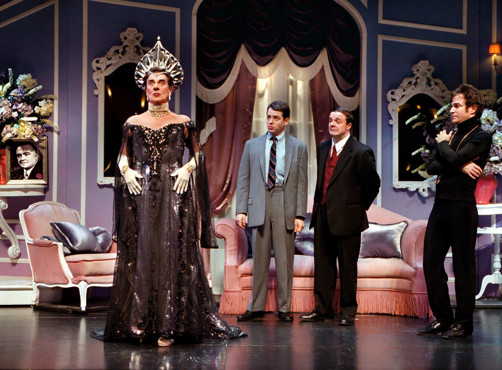 """Roger De Bris (Gary Beach) wearing """"The Chrysler"""" dress, and Leo and Max don't look pleased."""