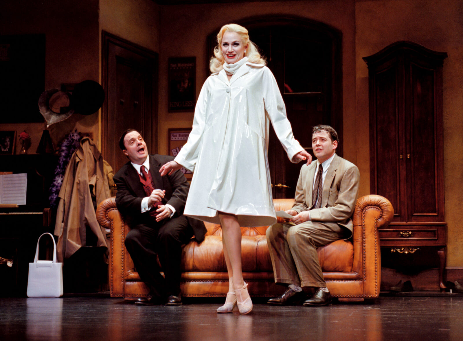 """Max Bialystock (Nathan Lane) and Leo Bloom (Matthew Broderick) watch Ulla (Cady Huffman) sing """"When You Got It, Flaunt It""""."""