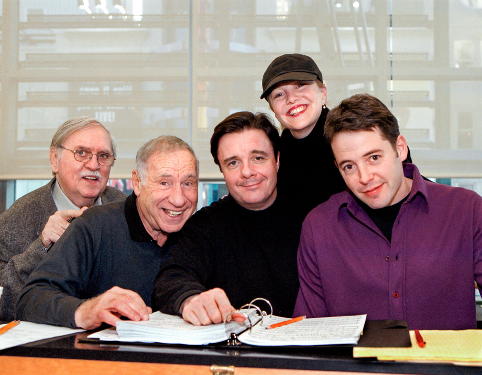 Tom Meehan, Mel Brooks, Nathan Lane, Susan Stroman, and Matthew Broderick in rehearsal for The Producers; huddled around a piano.