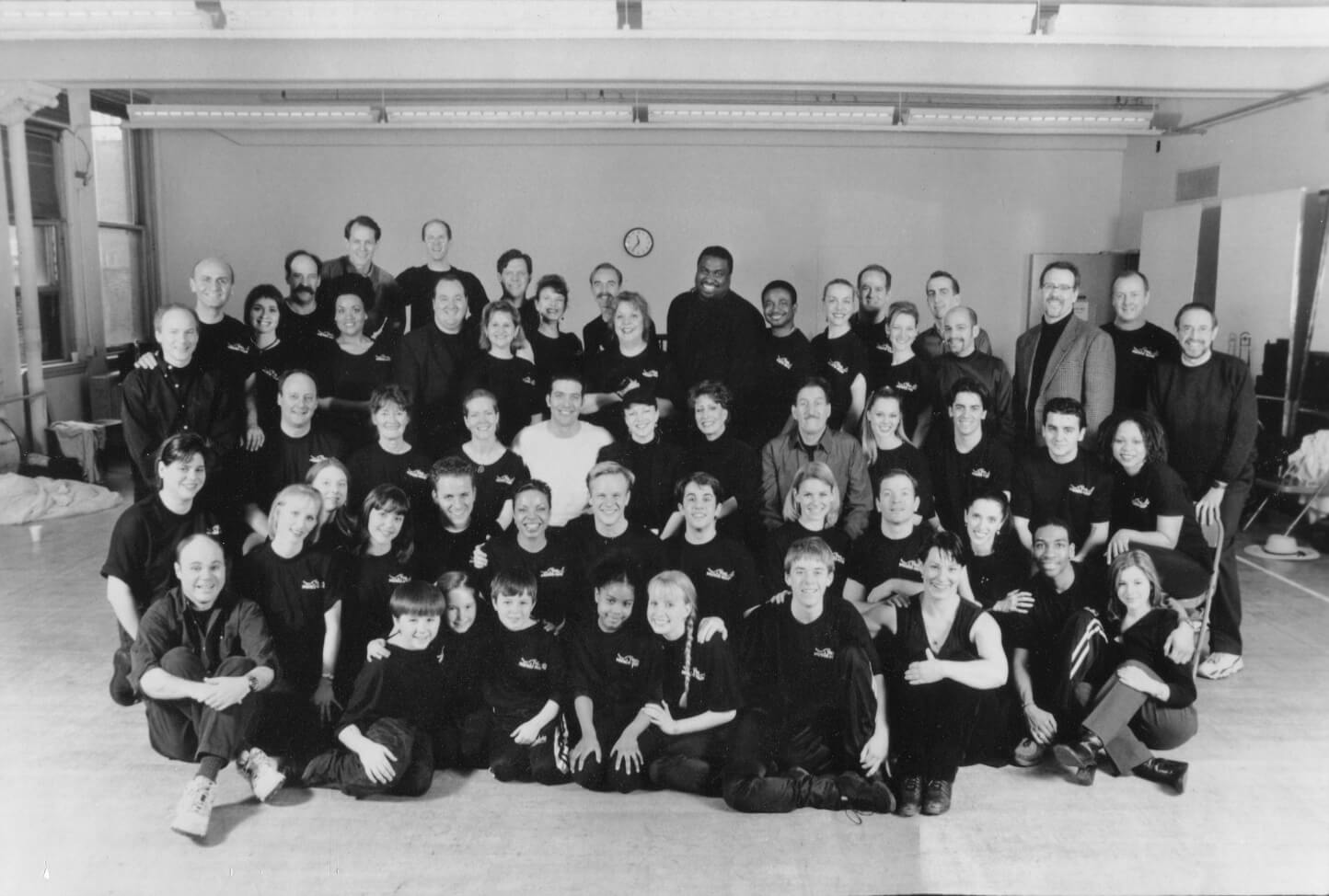 Susan Stroman with the full cast and creative team of The Music Man in a black and white photo.