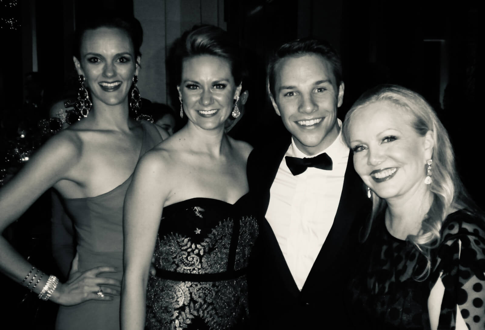 Leah Hofmann, Lauren Kadel, Josh Buscher, and Susan Stroman dressed up on Opening Night. The photo is in black and white.