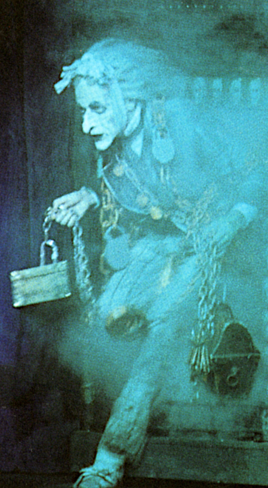 Marley's first entrance: a ghostly man entering through blue and grey smoke.