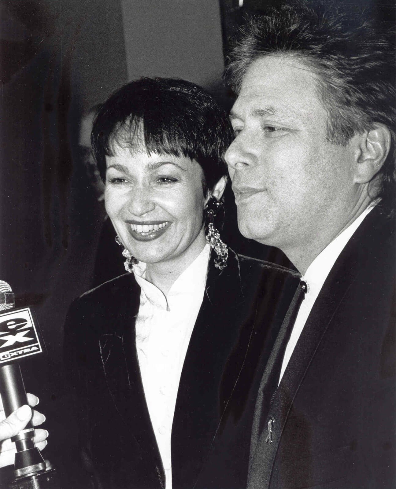 Lynn Ahrens and Alan Menken speaking to the press on opening night. Microphone from XTRA is in view.