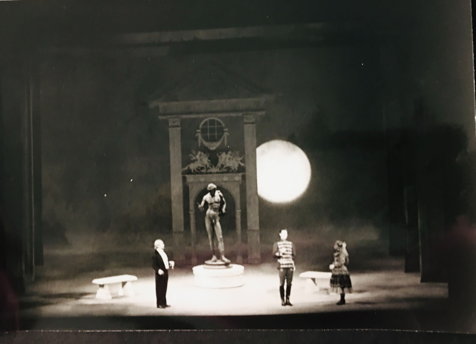 """Michael Anania's garden set for """"In Praise of Women"""". There is an a large David-like statue in the center under a full moon in A Little Night Music."""