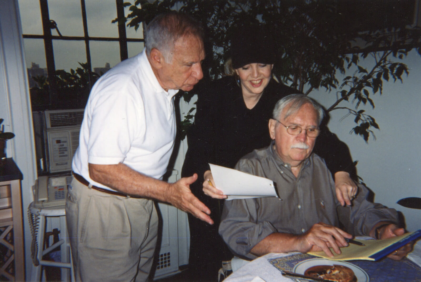Mel Brooks, Susan Stroman, and Thomas Meehan in an apartment working on the show over food.