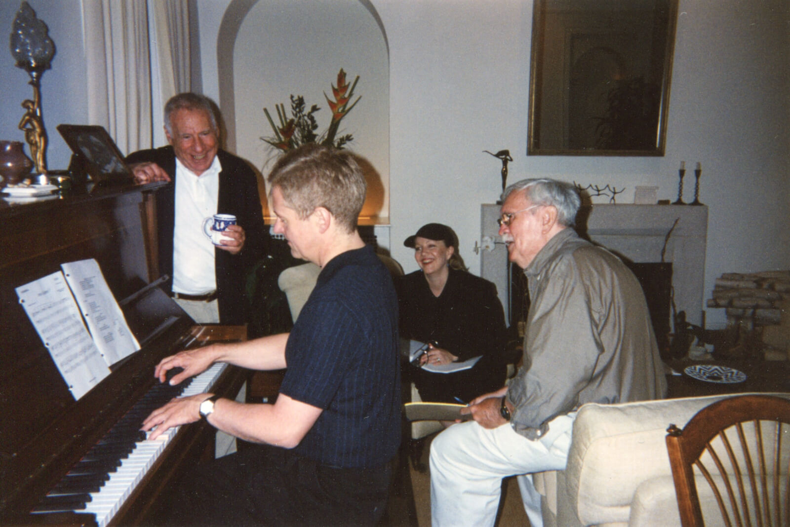 Glen Kelly at the piano, working on the show with Mel Brooks, Susan Stroman, and Thomas Meehan.