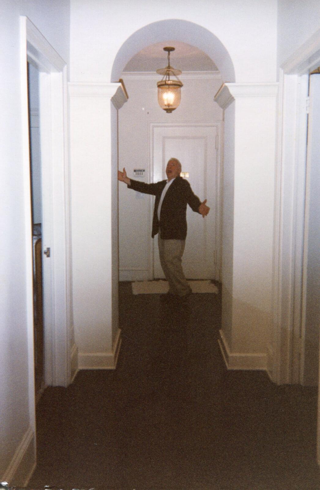 Mel Brooks entering Stro's apartment.