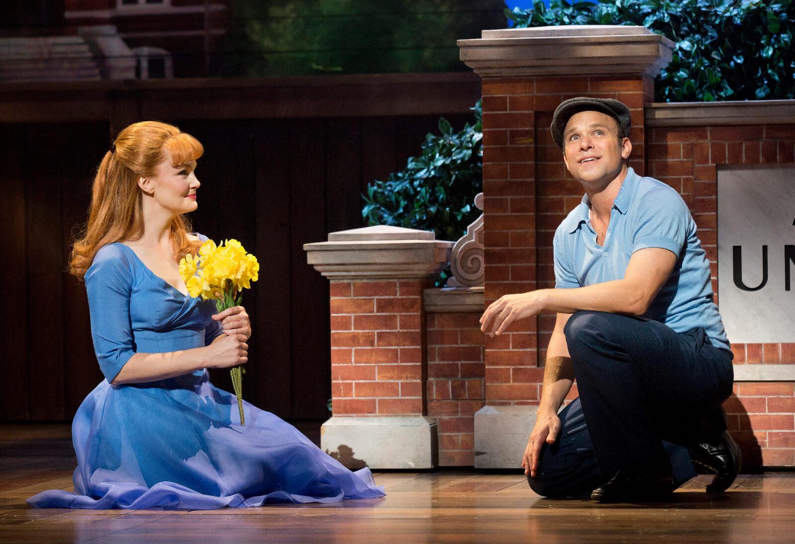 Sandra (Kate Baldwin) holds flowers as she and Edward Bloom (Norbert Leo Butz) share a moment.