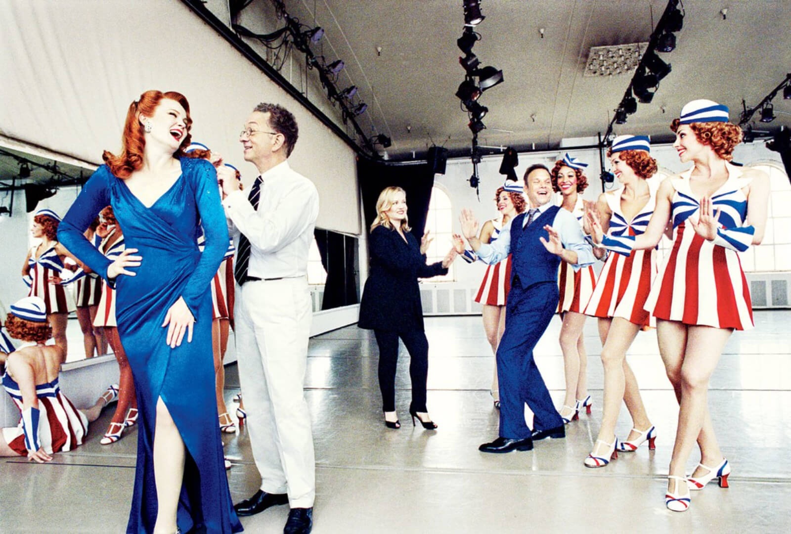 """Kate Baldwin, Costume Designer William Ivey Long, Susan Stroman and Norbert Leo Butz in a photo shoot for Vanity Fair. The cast is wearing their USO costumes from """"Red, White and True""""."""