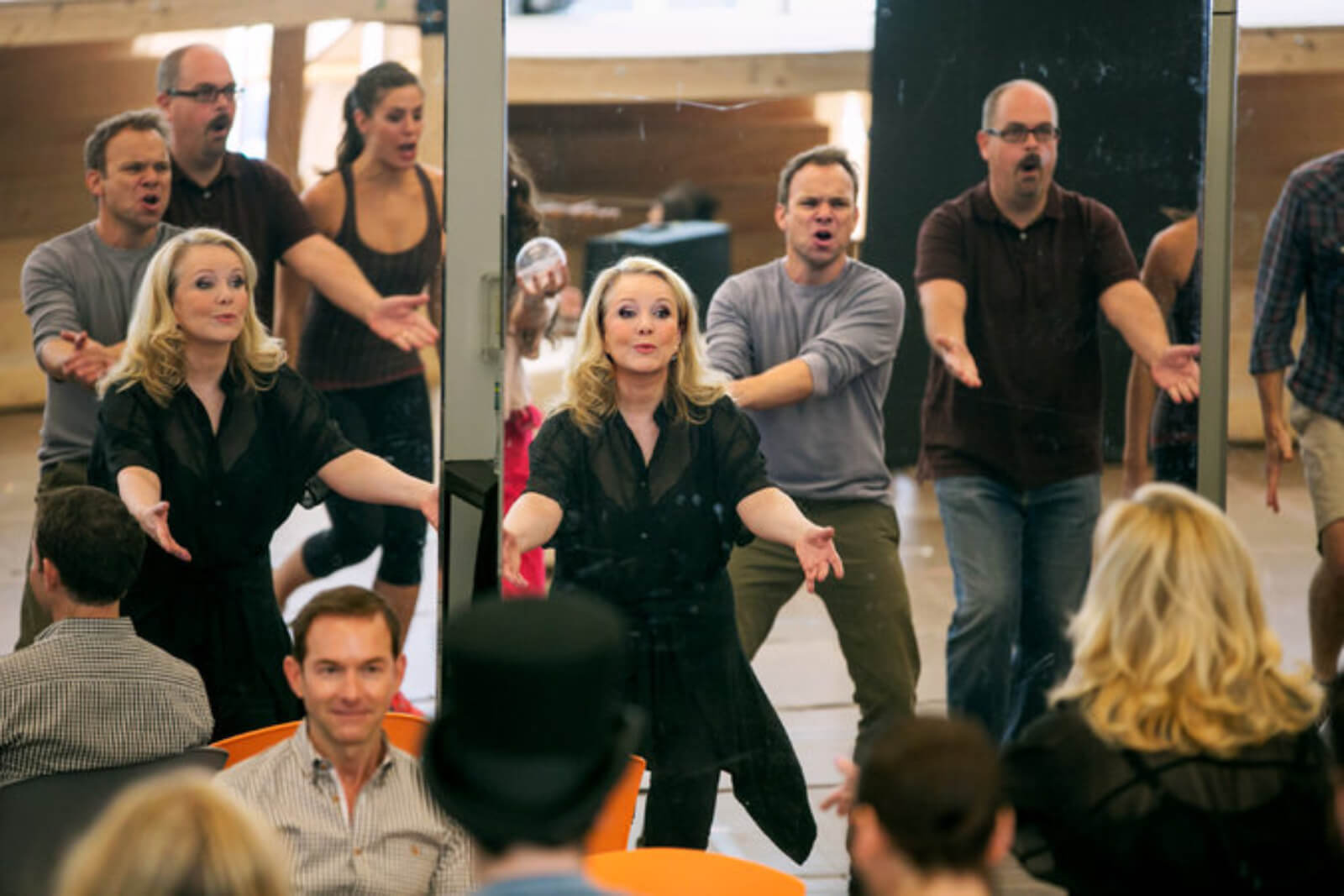 """Susan Stroman rehearses the cast of Big Fish in their opening number """"Be the Hero""""."""