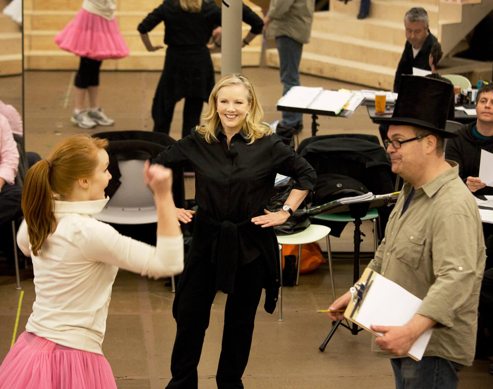Susan Stroman joyfully directs a scene with Kate Baldwin and Brad Oscar.