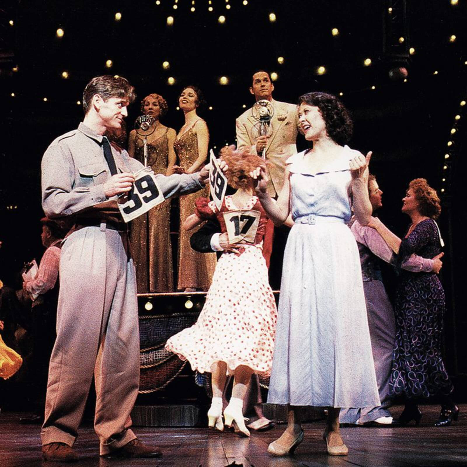 Bill Kelly (Daniel McDonald) ask Rita Racine (Karen Ziemba) to be his marathon dance partner.