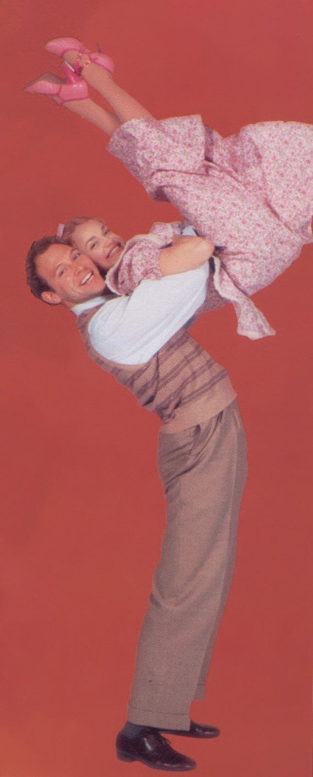 Happy McGuire (Jim Newman) dances with Precious McGuire (Kristin Chenoweth).