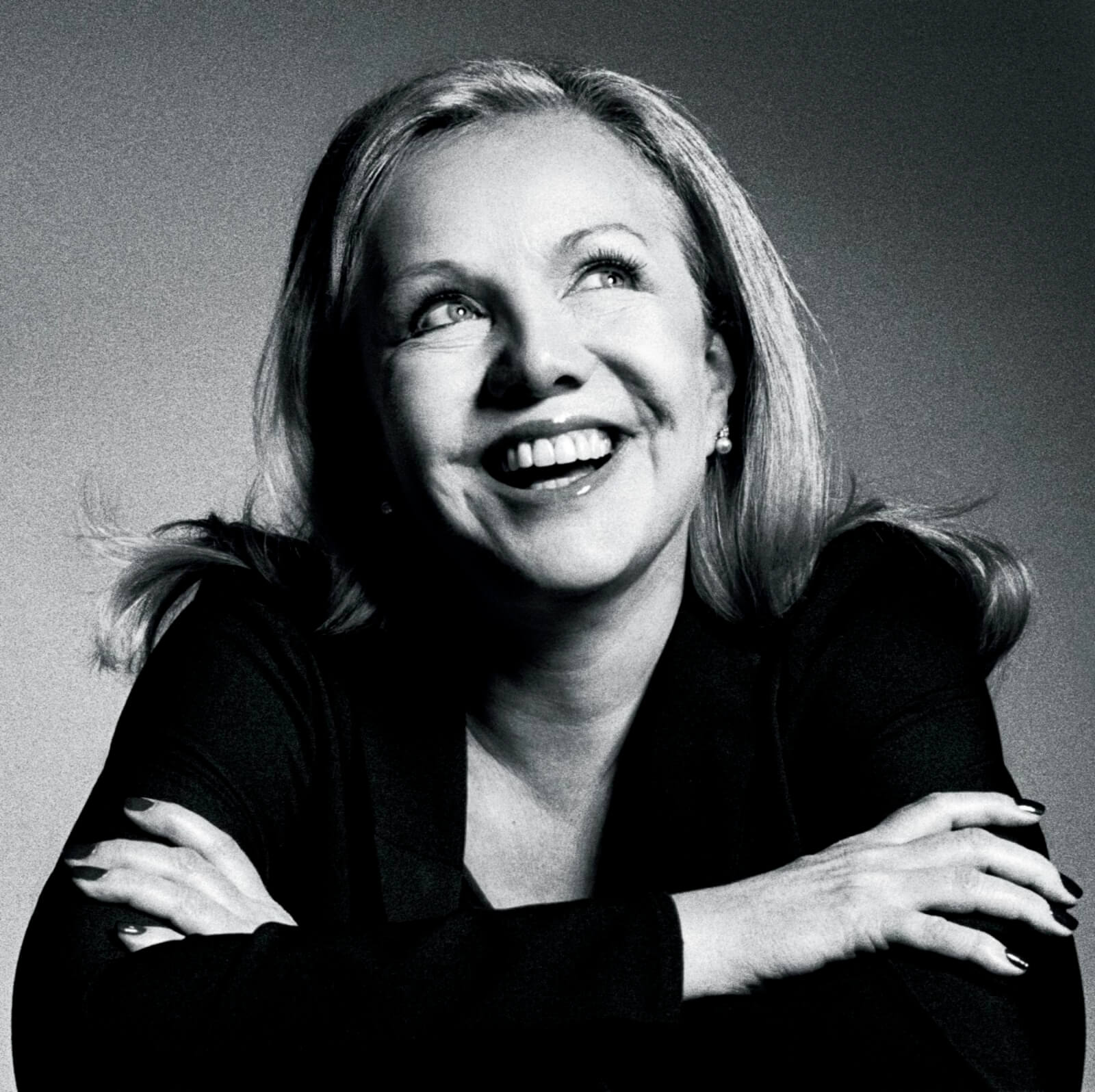 Susan Stroman in black and white looking up joyfully the right left.