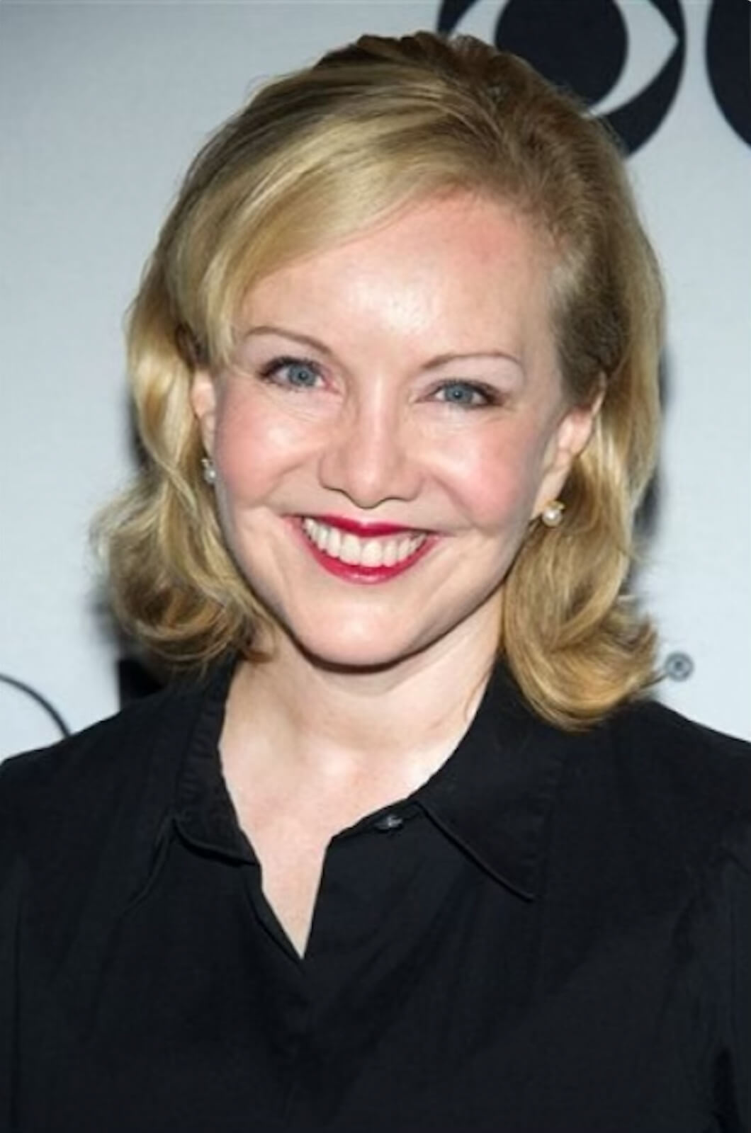 Headshot of Susan Stroman in front of the CBS step and repeat.