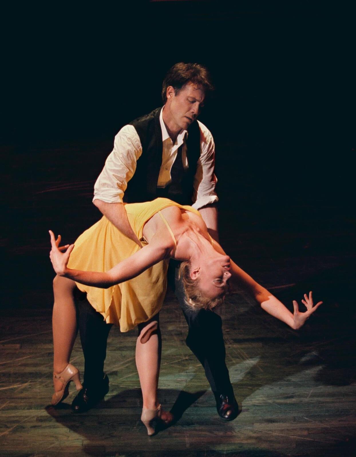 "Michael Wiley (Boyd Gaines) dips Girl in a Yellow Dress (Deborah Yates) in ""Contact""."