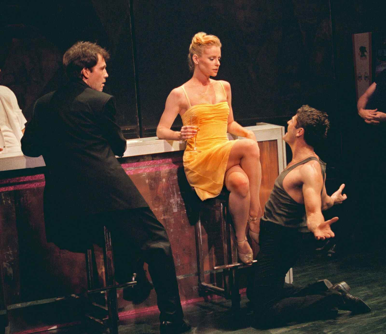 Michael Wiley (Boyd Gaines), Girl in the Yellow dress (Deborah Yates) sits at the bar with Johnny (Sean Martin Hingston) on his knees before her with outstretched arms.
