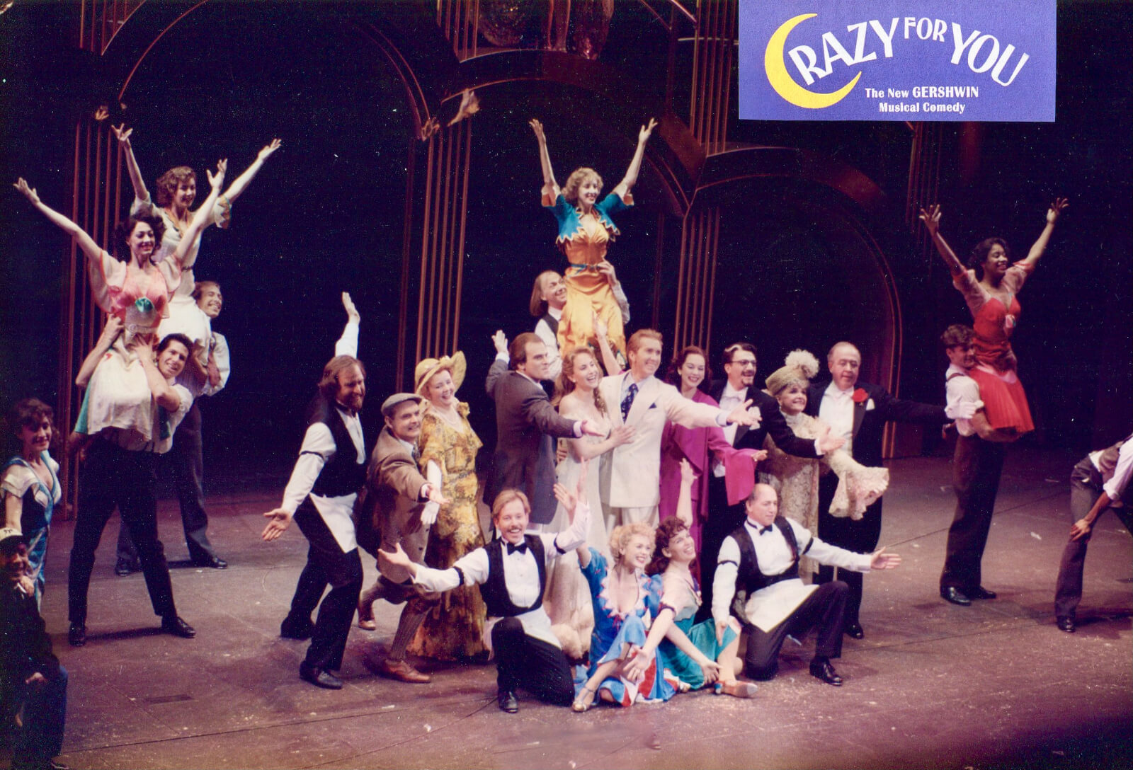 The Original Broadway Company of Crazy for You. They are in a pose for the button of the number.