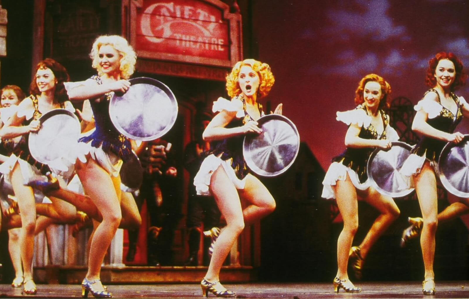 Ladies dancing with mining pans in West End's Original company of Crazy for You.