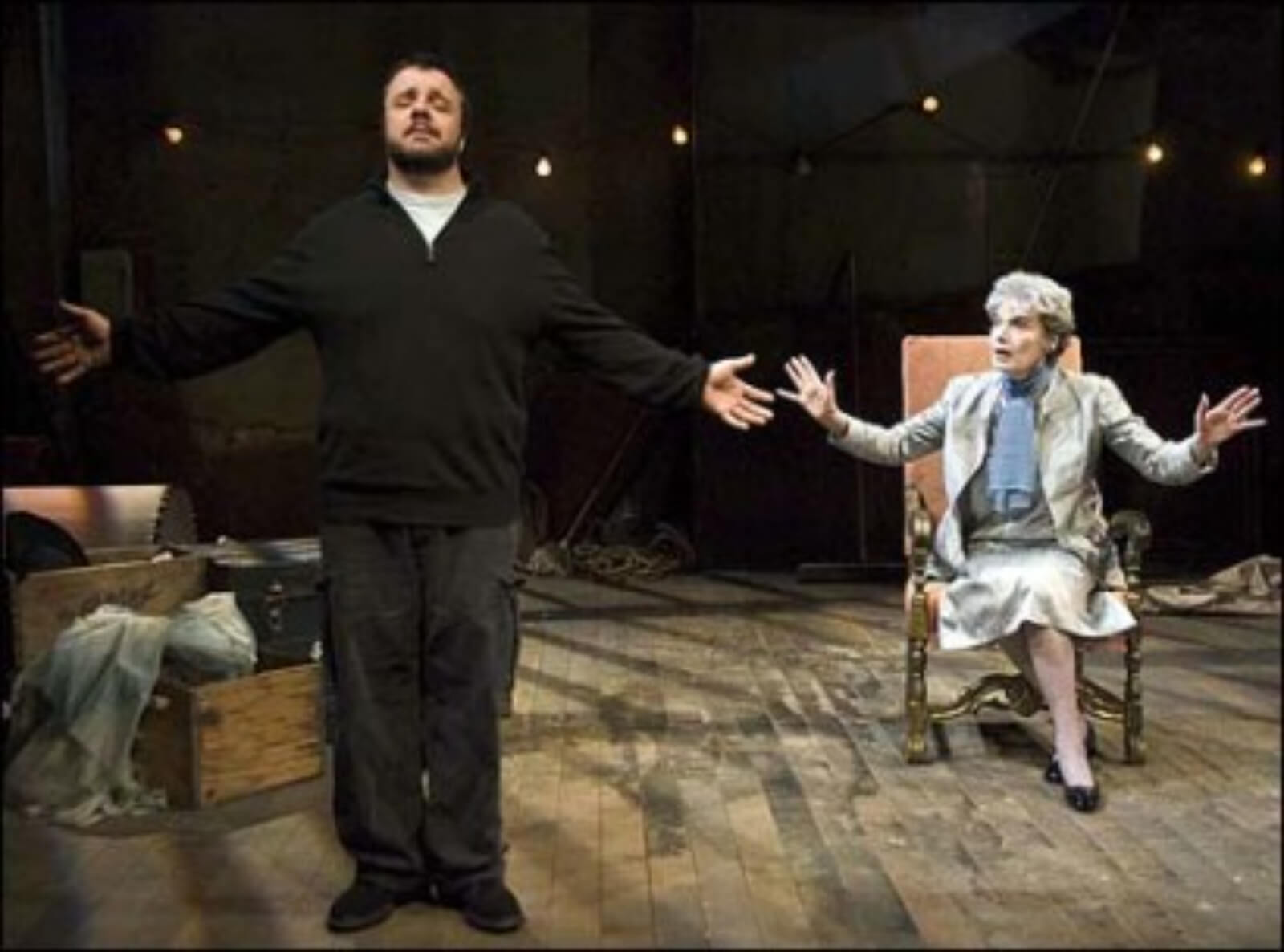 Lou Nuncle (Nathan Lane) stands with eyes closed and arms open while Annabelle Willard (Marian Seldes) sits behind him