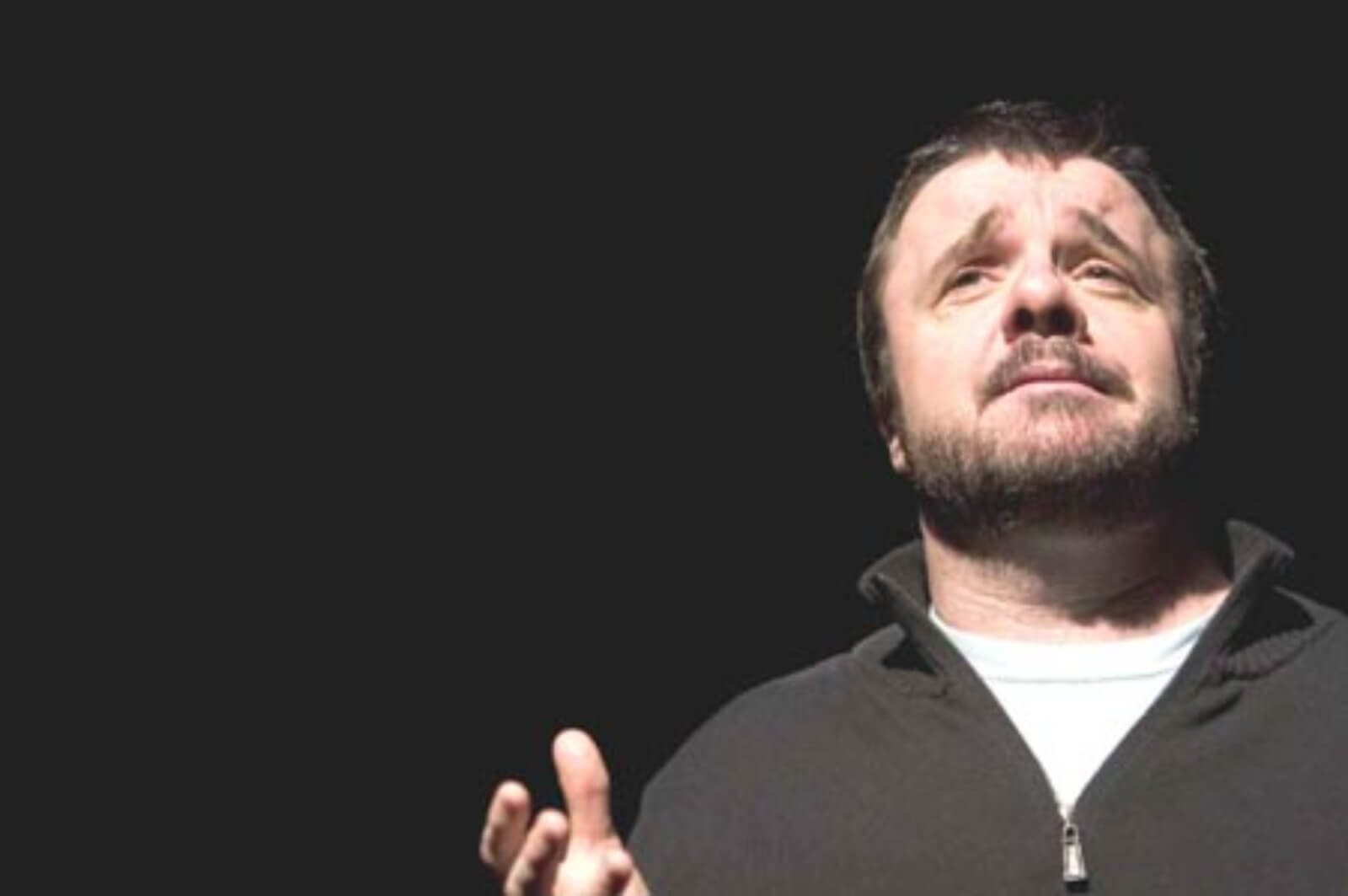 A close up Lou Nuncle (Nathan Lane) with an empathetic expression while performing in Dedication or the Stuff of Dreams