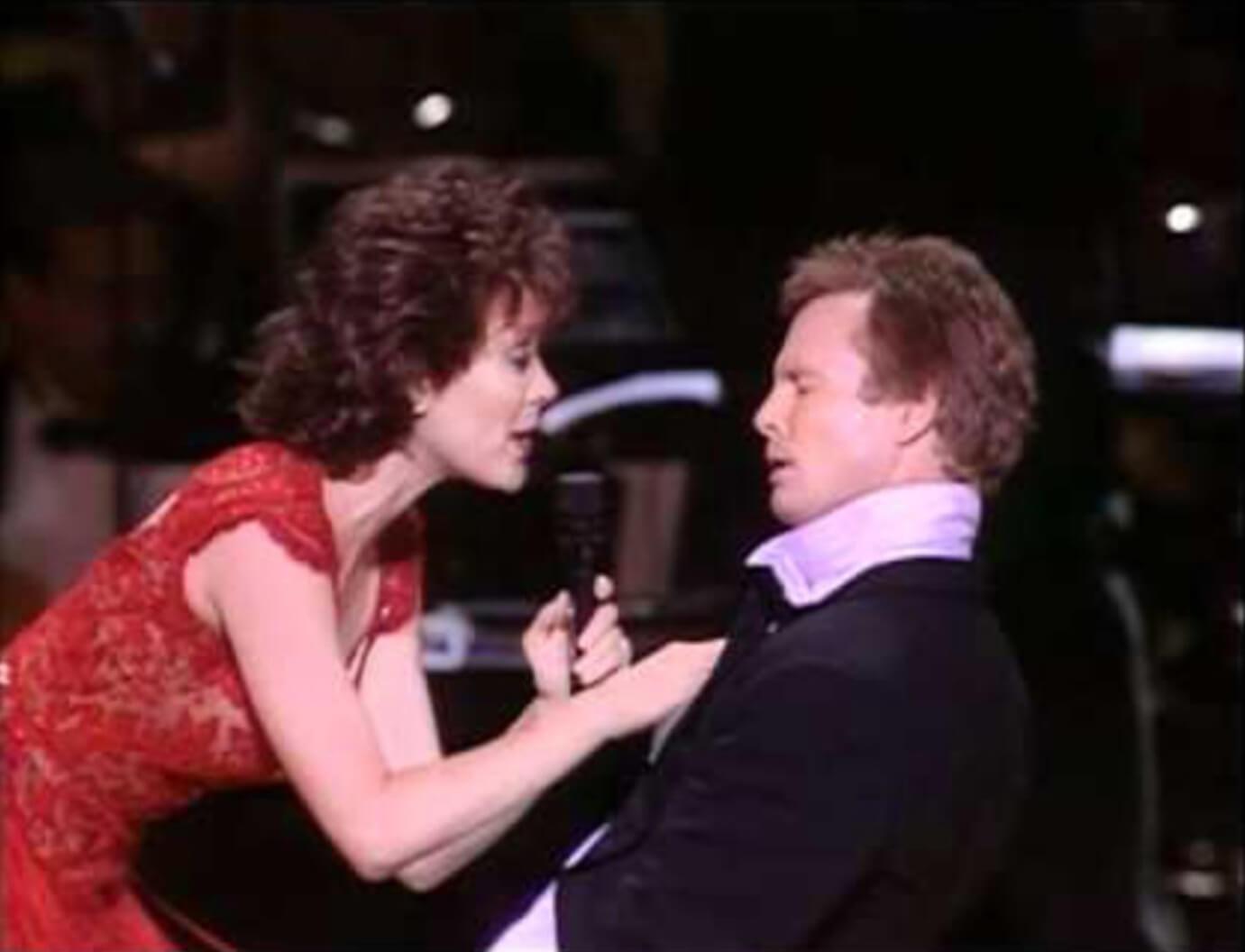 Karen Ziemba in a beautiful red dress convincing Bill Irwin.