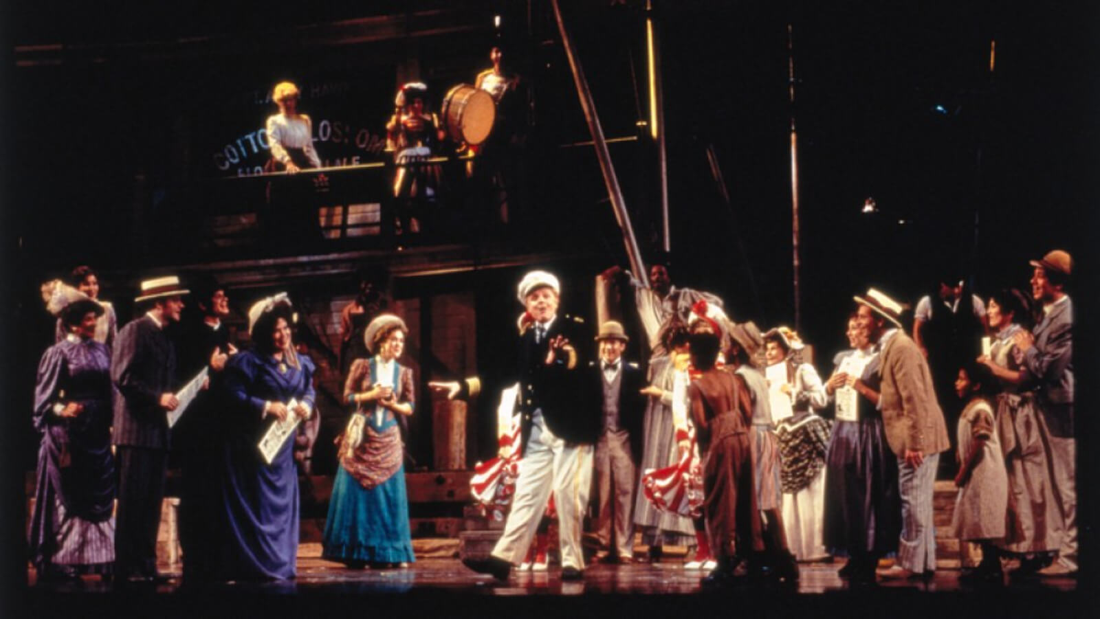 Captain Andy (John McMartin) and the cast, looking happy as he tells the crowd something pleasant and sweet. Everybody seems to be listening to what he's saying.