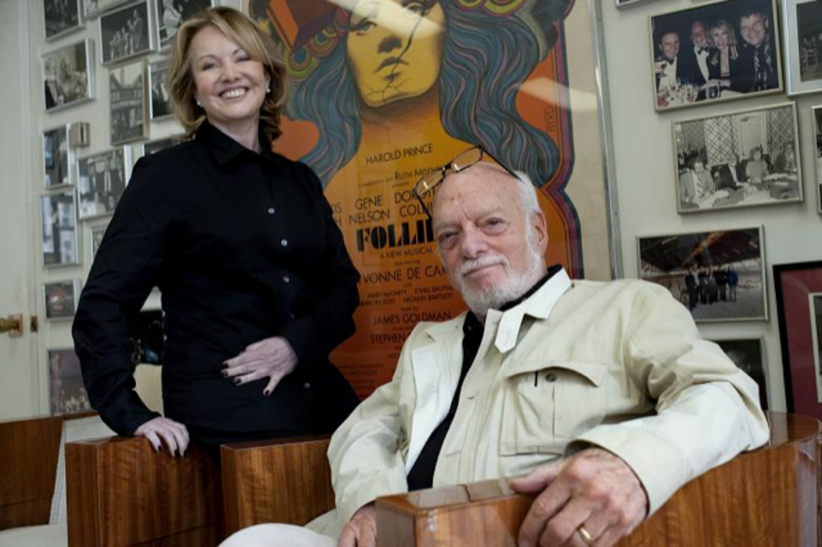 Susan Stroman (in an all black outfit) and Hal Prince (in beige jacket and eyeglasses over his head)