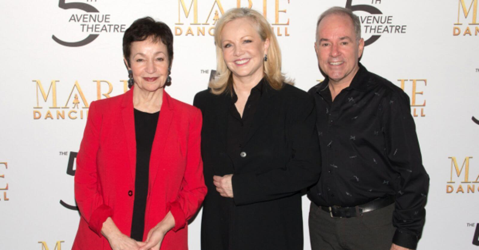 Lynn Ahrens (in a red blazer), Susan Stroman (in a black suit), and Stephen Flaherty (in black printed button up) at the opening night of Marie.