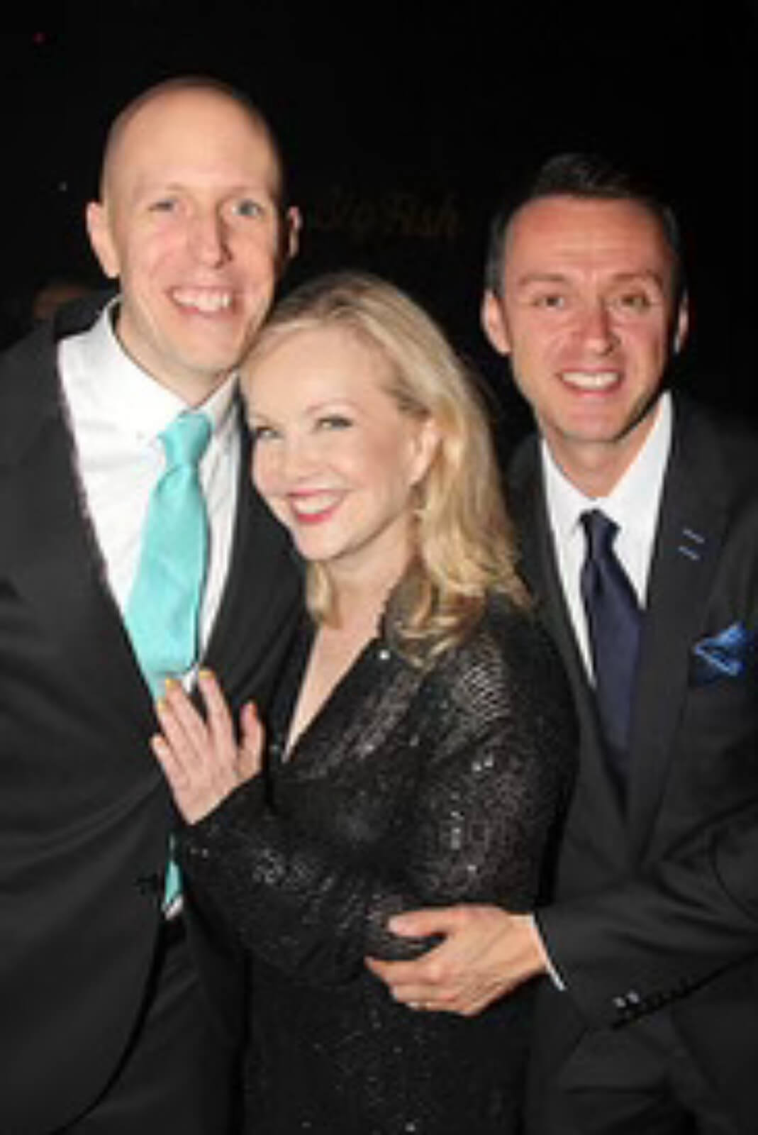 Susan Stroman, in a hug between John August and Andrew Lippa, at the opening night of Big Fish.