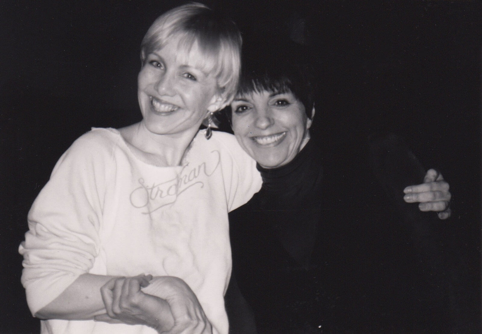 """Susan Stroman (in white """"Stroman"""" sweat shirt) and Liza Minnelli (in a black turtleneck) working together on her show at Radio City Music Hall."""