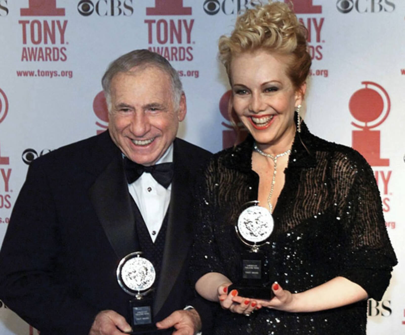 Mel Brooks and Susan Stroman on the red carpet holding Tony Awards, after The Producers received a total of 12 wins.