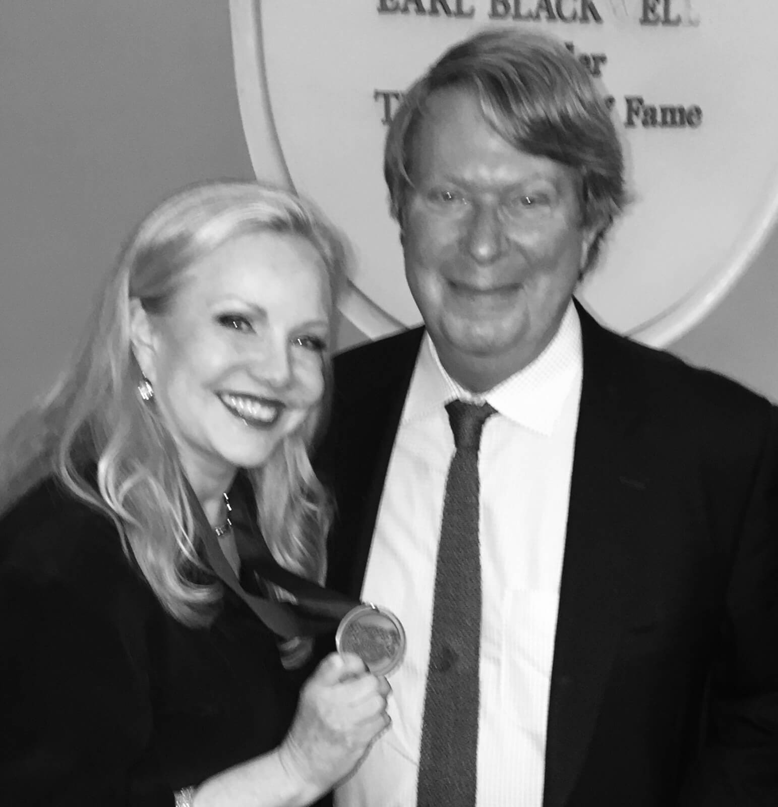 Susan Stroman with Andre Bishop, Artistic Director of Lincoln Center Theater, after being inducted into the Theater Hall of Fame. She is holding the award.