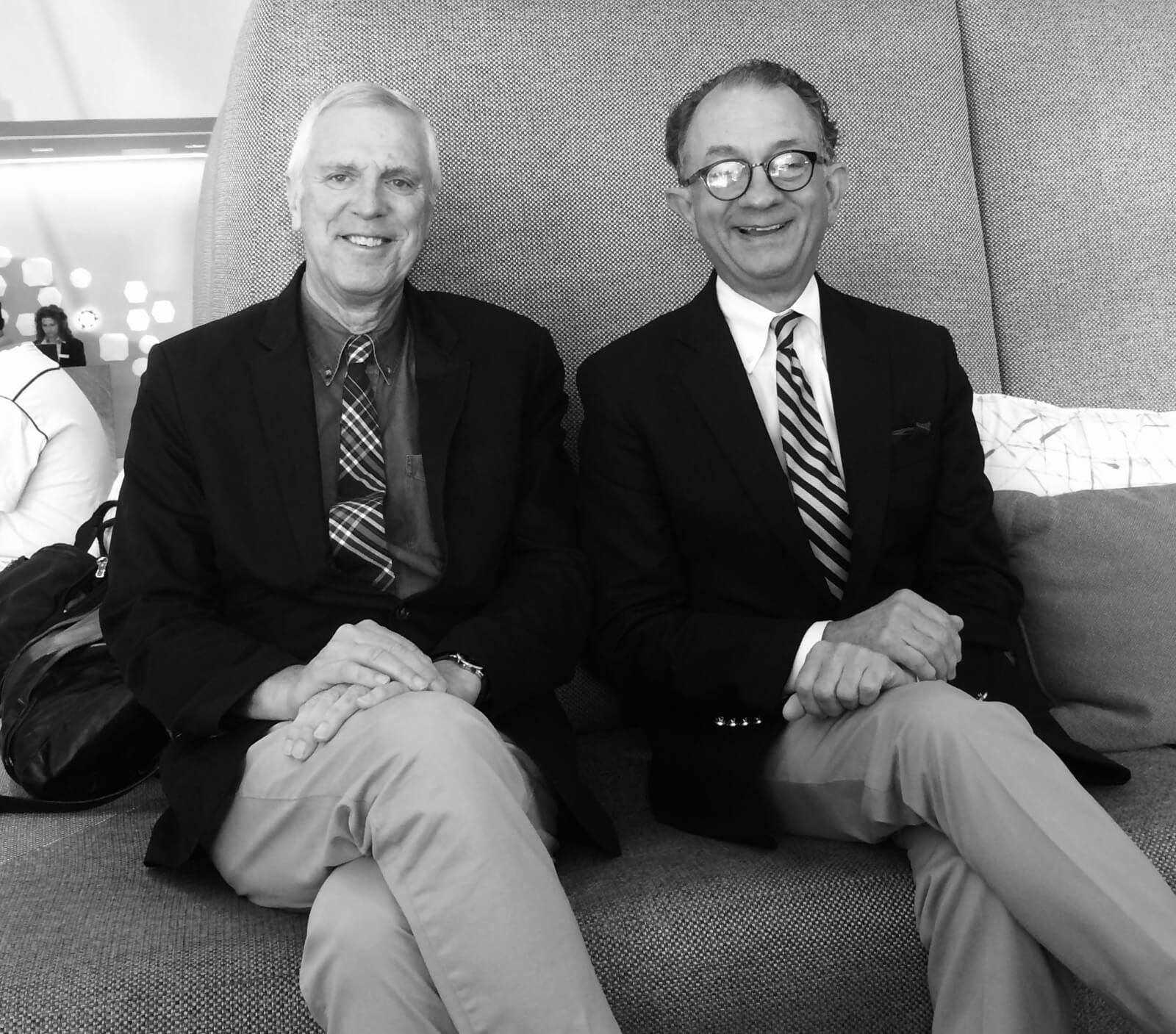 Seated are Stroman collaborators Ken Billington (lighting design) and William Ivey Long (costume design). Both are in blazers and wearing a tie.