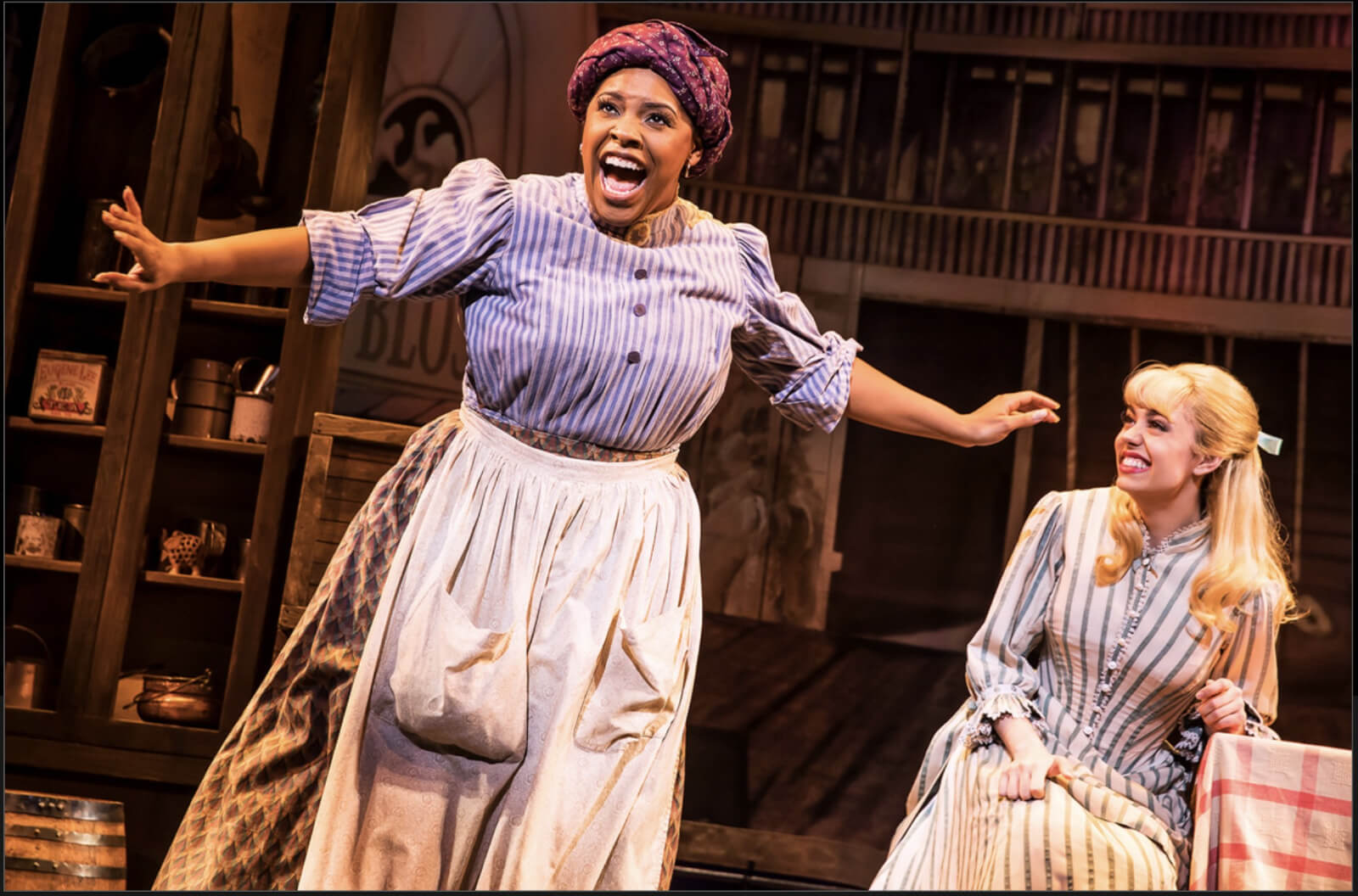 """Bryonha Marie Parham playing the role of Queenie from Showboat joyfully sings """"Can't Help Lovin' Dat Man of Mine"""". Kaley Ann Voorhees as Magnolia looks on in Prince of Broadway."""