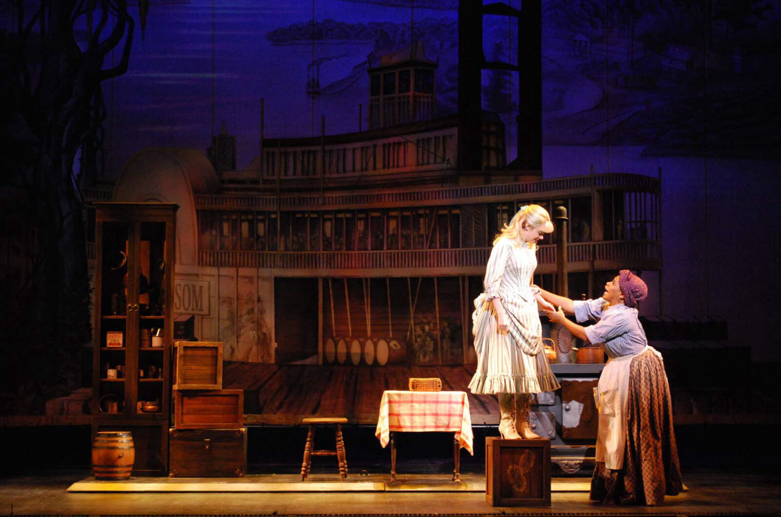 Kaley Ann Vorhees as Magnolia and Bryonha Marie Parham as Queenie in a scene from ShowBoat. Queenie fixes Magnolias hem in Prince of Broadway.