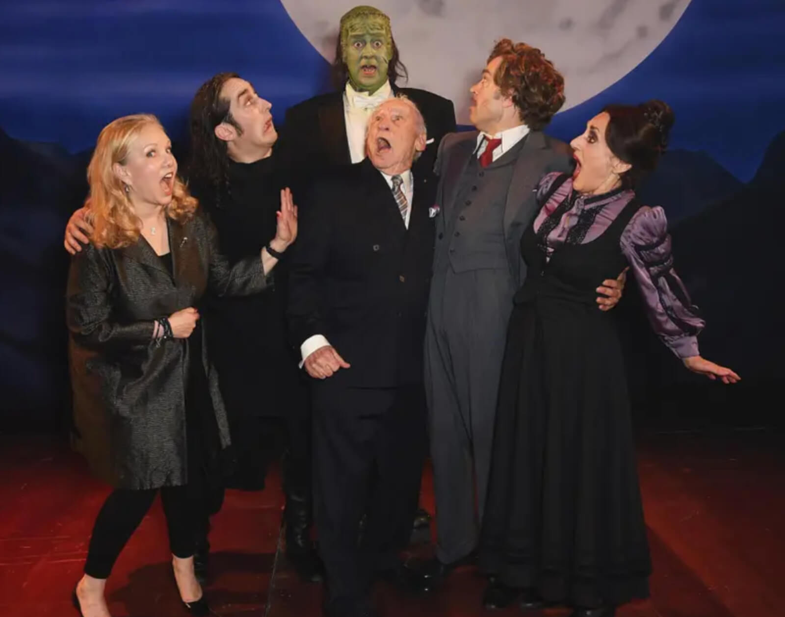 Susan Stroman and Mel Brooks (acting terrified) with the London company of Young Frankenstein.