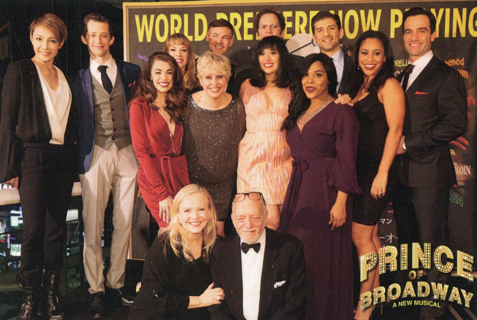 Susan Stroman and Hal Prince with the cast of Prince of Broadway opening night in Japan. They are all dressed in celebratory garb.