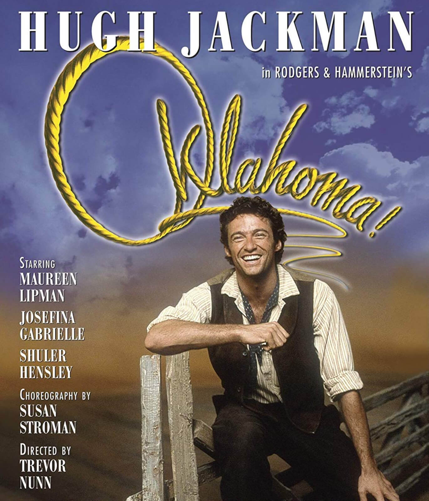 The show's logo poster with Hugh Jackman in the cover, smiling while sitting on a fence. The cast names are written on the left, and the title is strategically placed in the upper part of the page.
