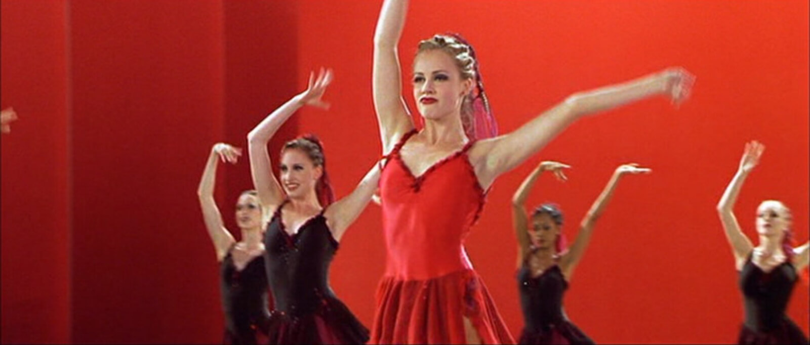 """A close up of Jody Sawyer (Amanda Schull) as she stands out in a red costume for """"Canned Heat"""" from Center Stage."""