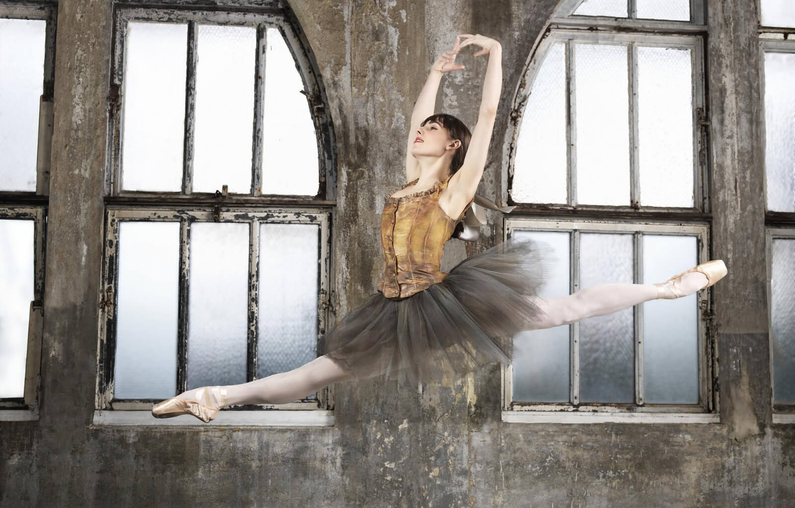 Marie (Tiler Peck) dancing a Grande Jeté from the musical, Little Dancer. She is wearing the exact costume from the Degas sculpture.